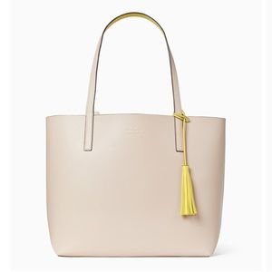 Brand new Kate Spade double sided leather tote .